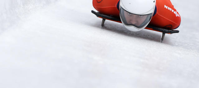 Kyle Tress of the United States speeds down the track during his first run of the men's Skeleton World Cup race in Koenigssee, southern Germany, on Saturday, Jan. 25, 2014. (AP Photo/Matthias Schrader)
