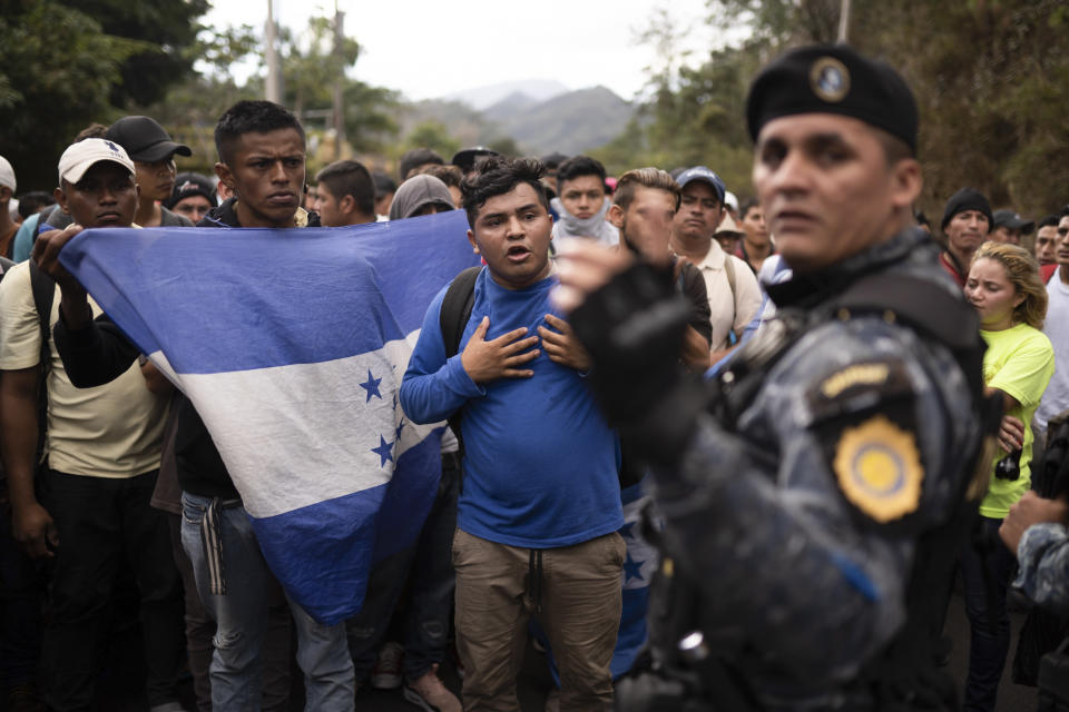 FILE - In this Jan. 16, 2020 file photo, Honduran migrants hoping to reach the U.S. border are stopped by Guatemalan police near Agua Caliente, Guatemala, on the border with Honduras. The reasons Hondurans continue to flee their country have been well documented: pervasive violence, deep-seated corruption, lack of jobs and widespread destruction from two major hurricanes that struck the region in November 2020. (AP Photo/Santiago Billy, File)