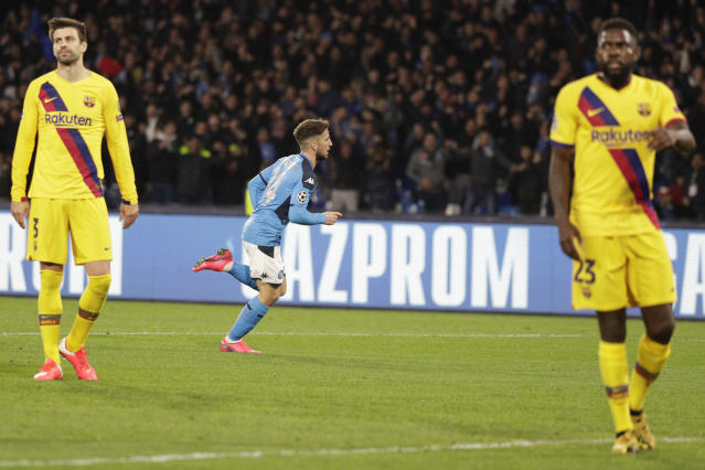 Napoli's Dries Mertens, center, celebrates after scoring during the Champions League, Round of 16, first-leg soccer match between Napoli and Barcelona, at the San Paolo Stadium in Naples, Italy, Tuesday, Feb. 25, 2020. (AP Photo/Andrew Medichini)