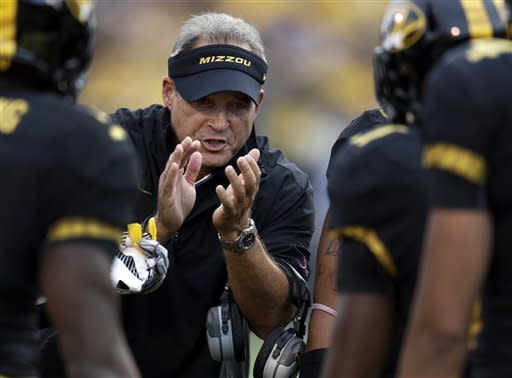 Missouri head coach Gary Pinkel applauds his team after a score during the first quarter of an NCAA college football game against Arizona State, Saturday, Sept. 15, 2012, in Columbia, Mo. (AP Photo/Jeff Roberson)