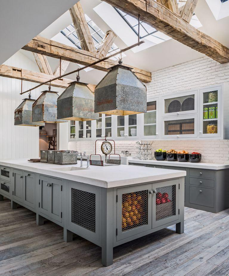 "<p>Feel free to mix it up: Unified cabinetry is a thing of the past. Here, Diane Keaton features contrasting white and gray storage in <a href=""https://www.countryliving.com/home-design/house-tours/news/a45926/diane-keaton-house-tour/"" rel=""nofollow noopener"" target=""_blank"" data-ylk=""slk:her beautifully rustic kitchen"" class=""link rapid-noclick-resp"">her beautifully rustic kitchen</a>. </p><p><a class=""link rapid-noclick-resp"" href=""https://www.amazon.com/s?k=cabinet+paints&ref=nb_sb_noss_1&tag=syn-yahoo-20&ascsubtag=%5Bartid%7C10050.g.3988%5Bsrc%7Cyahoo-us"" rel=""nofollow noopener"" target=""_blank"" data-ylk=""slk:SHOP CABINET PAINT"">SHOP CABINET PAINT</a></p>"