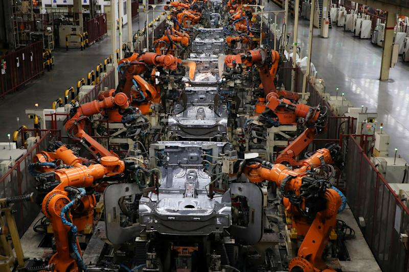 Robots weld bodyshells of car are pictured on the assembly line in the Proton manufacturing plant in Tanjung Malim, Malaysia, December 16, 2019. Picture taken December 16, 2019. REUTERS/Lim Huey Teng