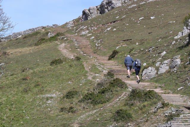People walk up the Great Orme in Llandudno, Wales, where lockdown restrictions have eased