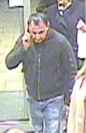 An image taken from CCTV shows a man the Metropolitan Police would like to speak to after a suitcase containing 1 million pounds ($1.3 million) worth of gems was stolen from a luggage rack on a train at London's Euston station