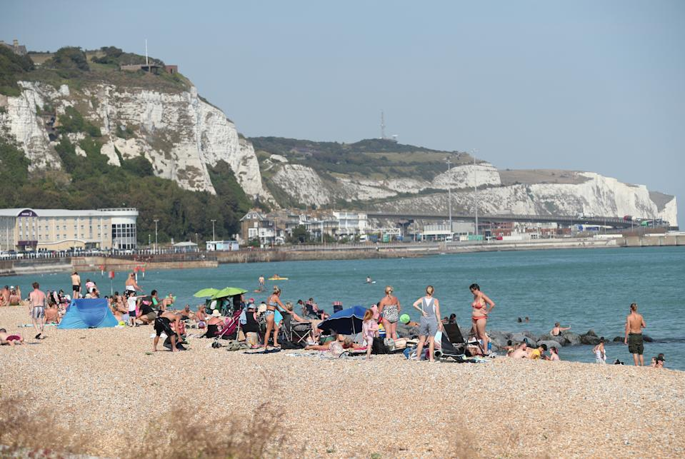People enjoying the warm weather on a beach in Dover, Kent.
