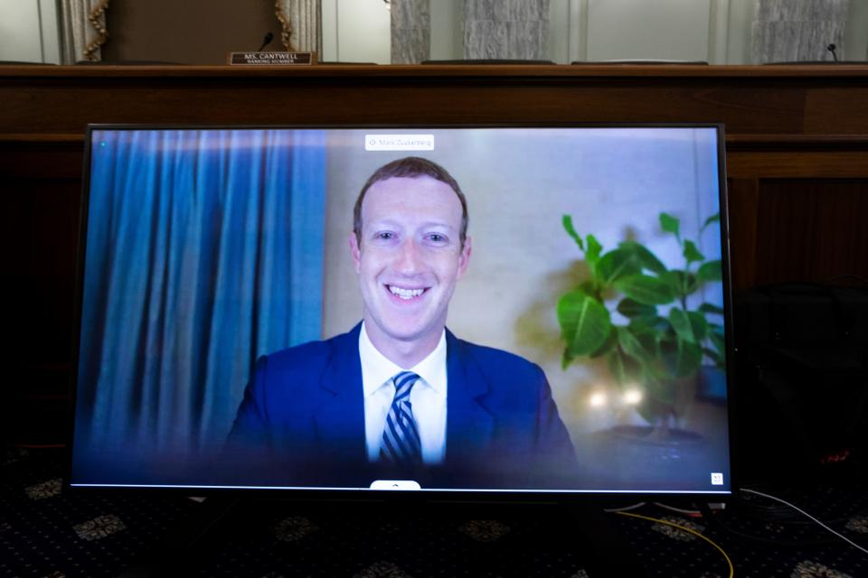 CEO of Facebook Mark Zuckerberg appears on a monitor as he testifies remotely during a  hearing to discuss reforming Section 230 of the Communications Decency Act with big tech companies on October 28, 2020 in Washington, DC. - US senators and tech CEOs girded for a clash Wednesday over a law making online services immune from liability for third-party content at a hearing set to debate Silicon Valley's handling of social media. (Photo by MICHAEL REYNOLDS / POOL / AFP) (Photo by MICHAEL REYNOLDS/POOL/AFP via Getty Images)
