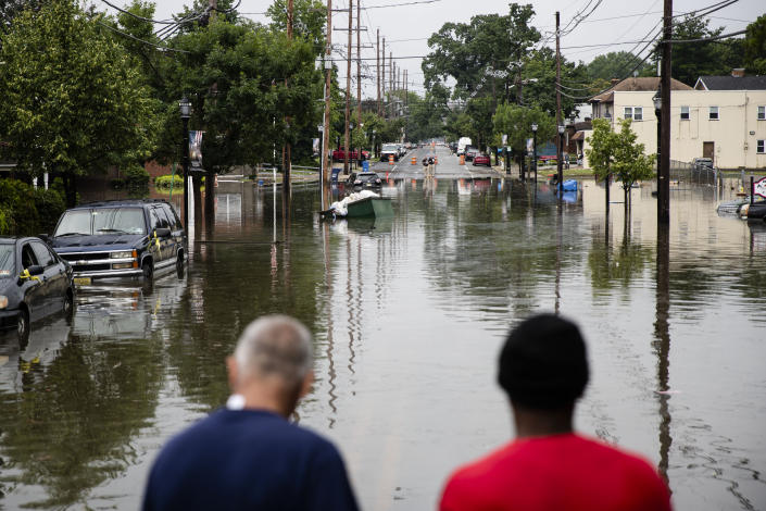 People inspect the floodwaters submerging Broadway in Westville, N.J. Thursday, June 20, 2019. Severe storms containing heavy rains and strong winds spurred flooding across southern New Jersey, disrupting travel and damaging some property. (Photo: Matt Rourke/AP)