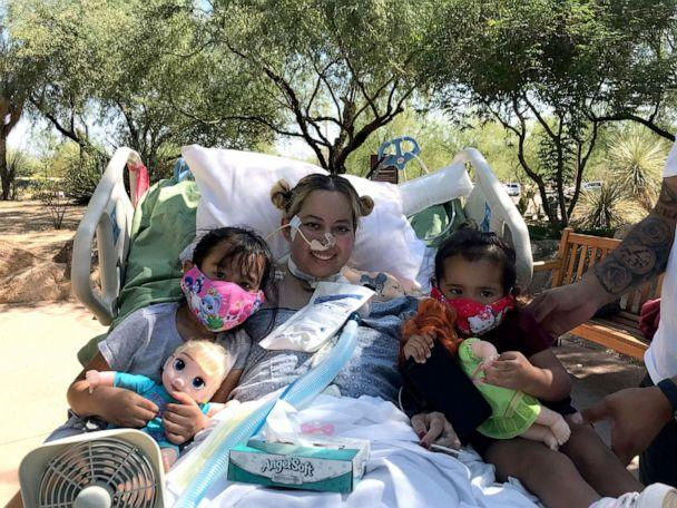 PHOTO: Reyna Lopez poses with her two daughters while hospitalized during her recovery from COVID-19. (Courtesy Rodolfo Lopez)