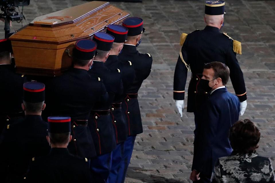 Emmanuel Macron stands in front of Samuel Paty's coffin (POOL/AFP via Getty Images)