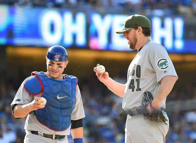 John Lackey #41 of the Chicago Cubs and Miguel Montero #47 of the Chicago Cubs check out the baseballs after the Los Angeles Dodgers scored 4 runs in the fifth inning at Dodger Stadium on May 27, 2017 in Los Angeles, California.