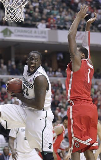 Michigan State forward Draymond Green (23) grabs a rebound against Ohio State forward Deshaun Thomas (1) in the first half of an NCAA college basketball game in the final of the Big Ten Conference men's tournament in Indianapolis, Sunday, March 11, 2012. (AP Photo/Michael Conroy)