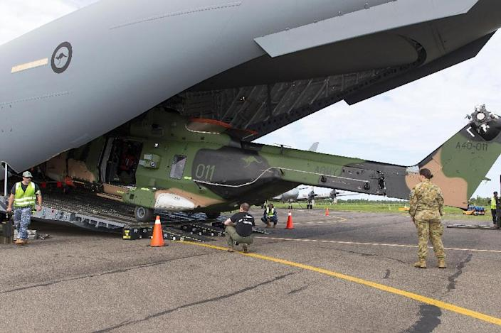 An Australian army MRH-90 helicopter being offloaded from a Royal Australian Air Force C-17A Globemaster aircraft at Fiji's Nausori International Airport in support of Operation Fiji Assist (AFP Photo/Abis Chris Beerens)