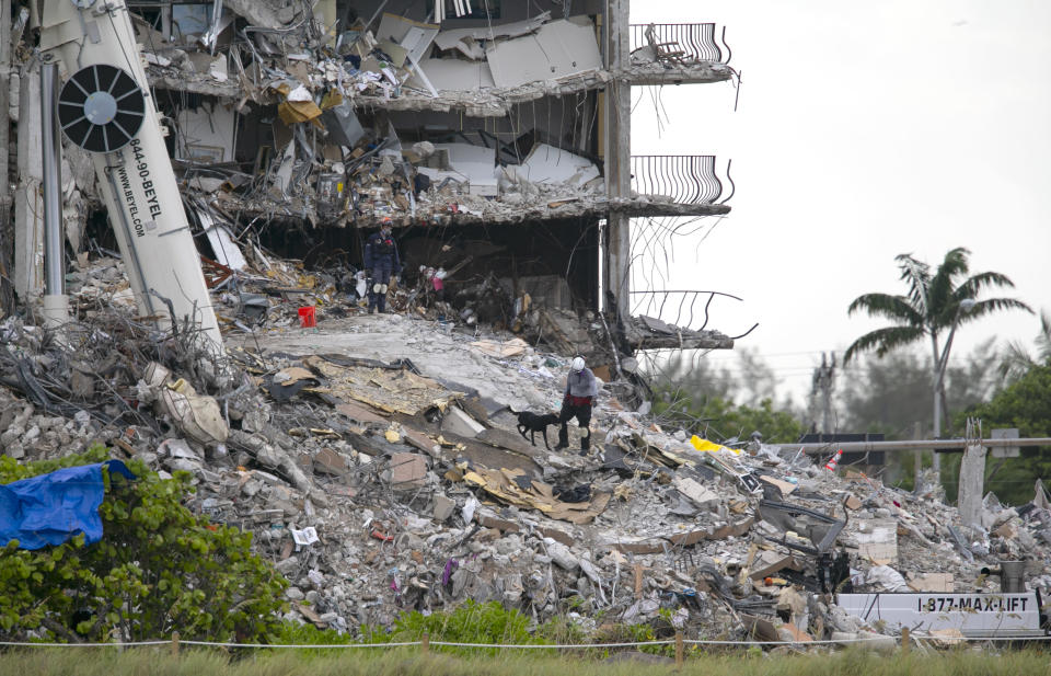 South Florida Urban Search and Rescue team look through rubble for survivors at the partially collapsed Champlain Towers South condo building in Surfside, Florida on Monday, June 28, 2021. As of early morning Monday, 152 people are missing and the death toll has climbed to nine.(Matias J. Ocner/Miami Herald via AP)