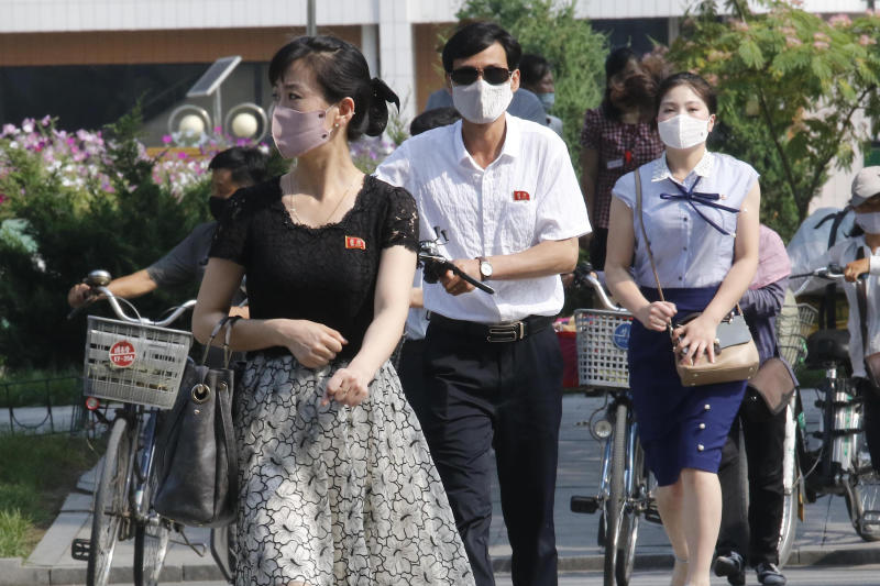 "People wearing masks walk in the Ryomyong street in Pyongyang, North Korea Friday, July 3, 2020. North Korean leader Kim Jong Un urged officials to maintain alertness against the coronavirus, warning that complacency risked ""unimaginable and irretrievable crisis,"" state media said Friday. (AP Photo/Jon Chol Jin)"