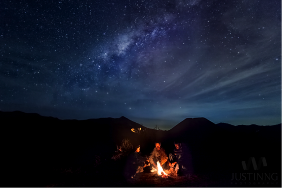 A single exposure shot of three native Indonesians warming themselves up on Mount Bromo under harsh weather conditions on Sept. 8, 2013.