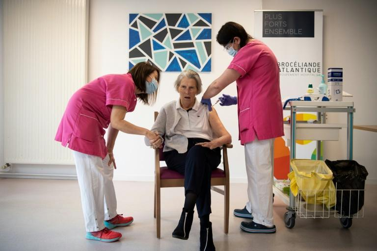 Blandine Johannel, a mursing home resident, receives a dose of the Pfizer-BioNTech Covid-19 vaccine during a vaccination campaign in Vannes, western France on January 7, 2021