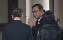 Thailand's Prime Minister Prayuth Chan-ocha, center, arrives at government house in Bangkok, Thailand, Thursday, June 6, 2019. Thailand's Parliament elected 2014 coup leader Prayuth Chan-ocha as prime minister in a vote Wednesday that helps ensure the military's sustained dominance of politics since the country became a constitutional monarchy nearly nine decades ago. (AP Photo/Sakchai Lalit)