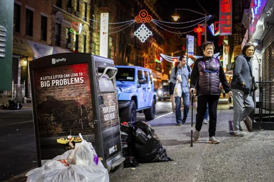 Bin in New York's Chinatown warns 'a little litter can lead to big problems' (Stephen Speranza/The New York Times)