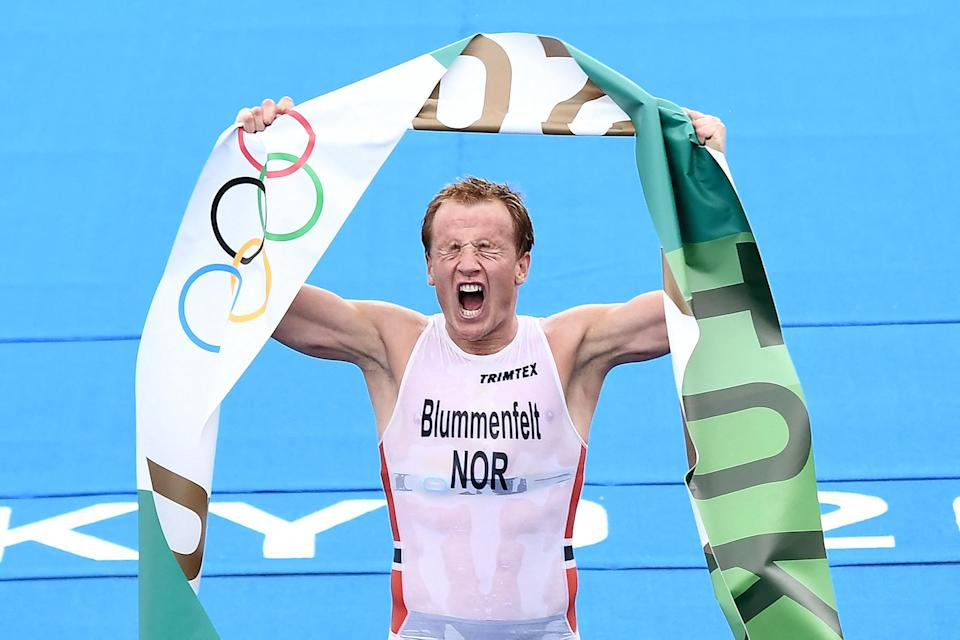 <p>Norway's Kristian Blummenfelt celebrates his gold medal finish in the men's individual triathlon competition on July 26.</p>