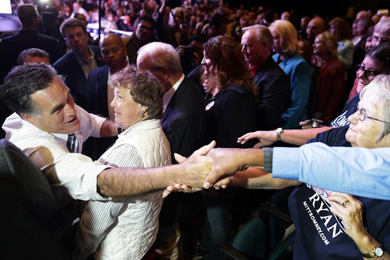Republican presidential candidate, former Massachusetts Gov. Mitt Romney reaches to shake hands with supporters at an election campaign rally at the Reno Event Center in Reno, Nev., Wednesday, Oct. 24, 2012. (AP Photo/Charles Dharapak)