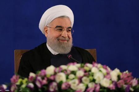 Iranian president Hassan Rouhani attends a news conference in Tehran