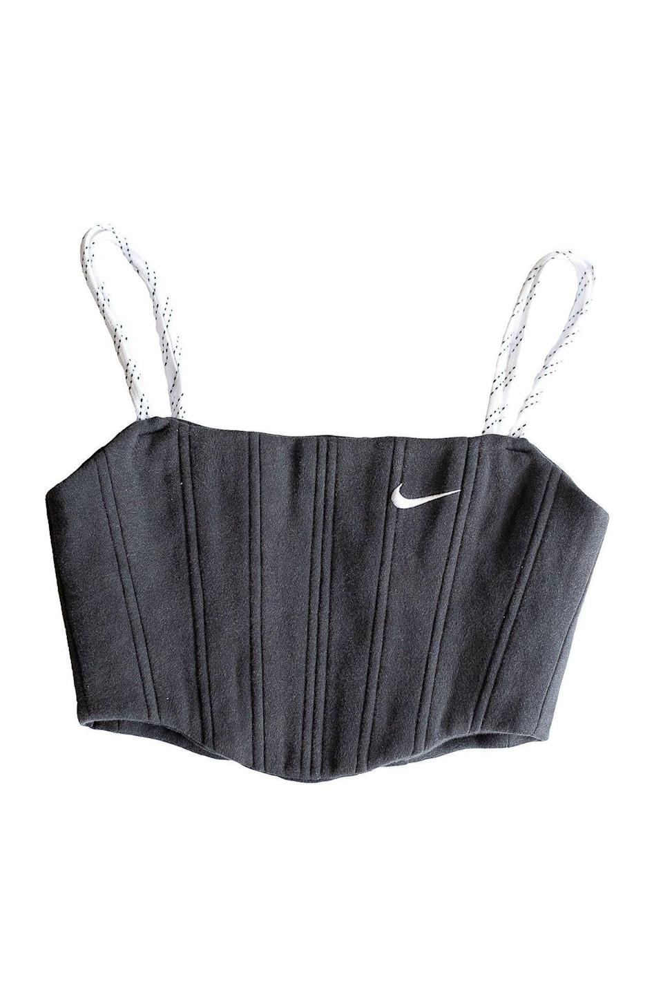 "<p><strong>almost.on.time</strong></p><p>almostontimesf.com</p><p><strong>$150.00</strong></p><p><a href=""https://almostontimesf.com/products/basic-black-nike-sweats-corset"" rel=""nofollow noopener"" target=""_blank"" data-ylk=""slk:SHOP IT"" class=""link rapid-noclick-resp"">SHOP IT</a></p><p>A fitted corset made from Nike sweats? Absolutely. These are all sold out, but stay on top of the drops for one-of-a-kind sexy sportswear that will make everyone you know insanely jealous.</p>"