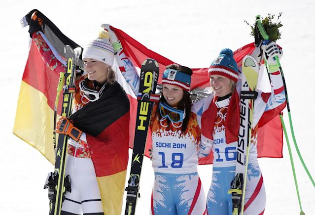 Women's super-G medalists from left, Germany's Maria Hoefl-Riesch (silver), Austria's Anna Fenninger (gold) and Austria's Nicole Hosp (bronze) pose for photographers on the podium at the Sochi 2014 Winter Olympics, Saturday, Feb. 15, 2014, in Krasnaya Polyana, Russia. (AP Photo/Christophe Ena)