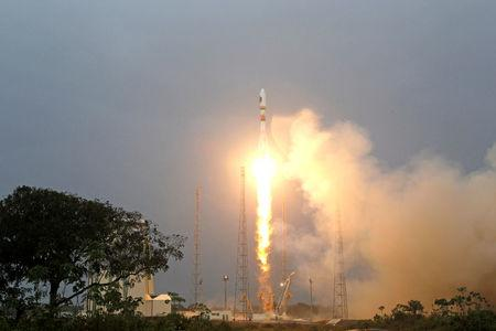 FILE PHOTO: The Russian Soyuz VS01 rocket, carrying the first two satellites of Europe's Galileo navigation system, blasts off from its launchpad at the Guiana Space Center in Sinnamary