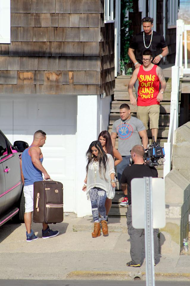 "They're baa-ack! The ""Jersey Shore"" cast, including Paul ""DJ Pauly D"" DelVecchio, Vinny Guadagnino, Ronnie Ortiz-Magro, Deena Cortese, and Mike ""The Situation"" Sorrentino, was spotted moving back into their beloved summer rental in Seaside Heights, New Jersey, on Thursday. (5/31/2012)"