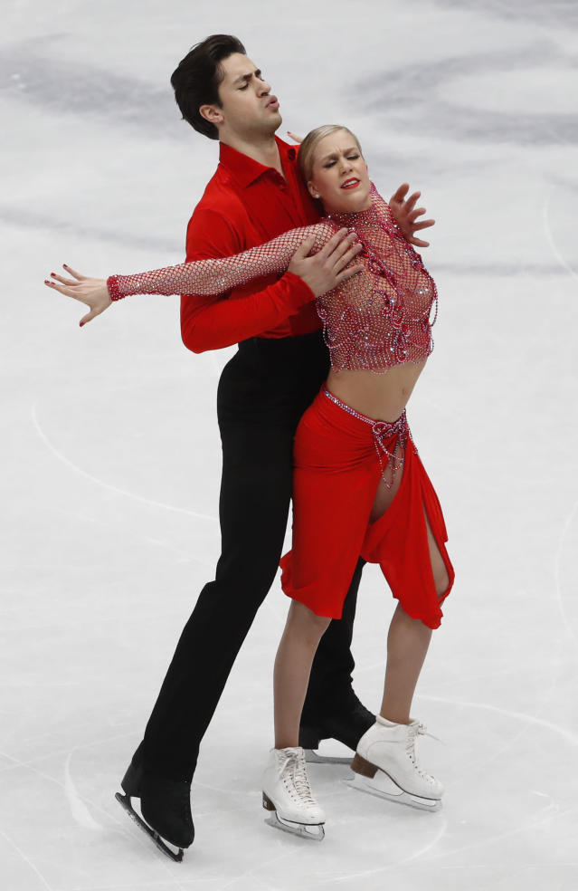 Kaitlyn Weaver and Andrew Poje of Canada perform during the pairs Ice dance short program at the Figure Skating World Championships in Assago, near Milan, Friday, March 23, 2018. (AP Photo/Antonio Calanni)