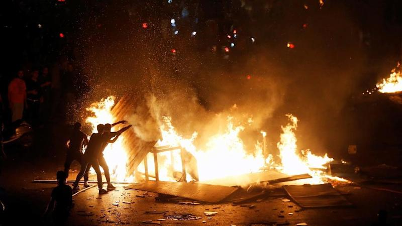 Protests spread across Lebanon over proposed new taxes