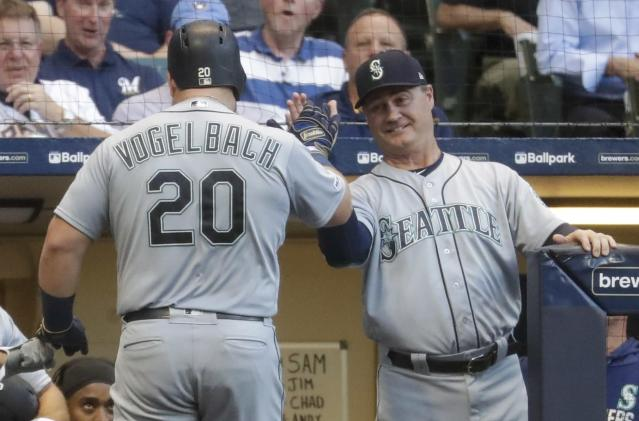 Seattle Mariners' Daniel Vogelbach is congratulated by manager Scott Servais after hitting a home run during the third inning of a baseball game against the Milwaukee Brewers Tuesday, June 25, 2019, in Milwaukee. (AP Photo/Morry Gash)