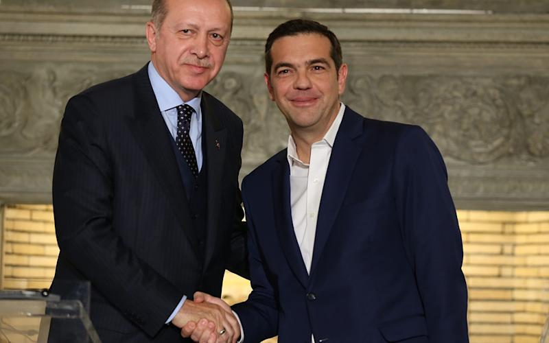 Turkish President Recep Tayyip Erdogan (L) and Greek Prime Minister Alexis Tsipras (R) shake hands after their joint press conference in Athens, Greece on December 07, 2017. - Anadolu