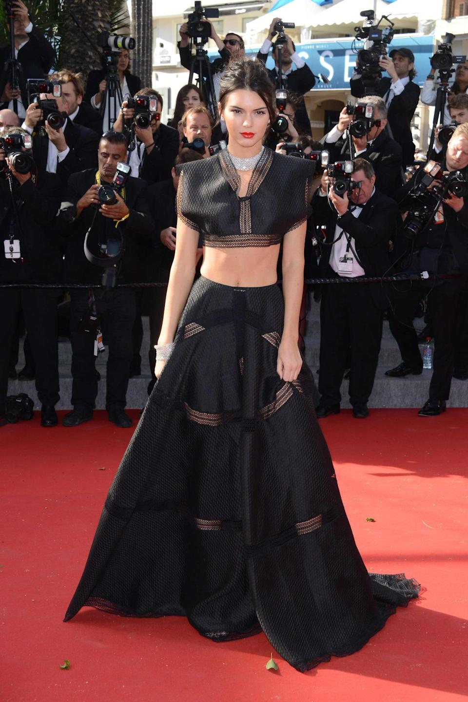 <p>For her first-ever red carpet appearance at the Cannes Film Festival, Jenner wore a va-va-voom Azzedine Alaïa black crop top and ball skirt combo. She posed and twirled, perfectly showing off her outfit's sexy illusion panels.</p>