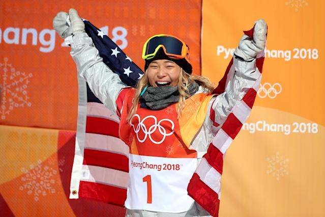 PYEONGCHANG, SOUTH KOREA – FEBRUARY 13: Gold medalist Chloe Kim #1 of the United States celebrates her gold medal win during the Snowboard – Ladies' Halfpipe competition. (Getty Images)