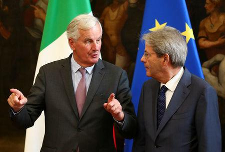 European Union's chief Brexit negotiator Michel Barnier (L) speaks with Italy's Prime Minister Paolo Gentiloni during a meeting in Rome, Italy September 21, 2017.    REUTERS/Alessandro Bianchi