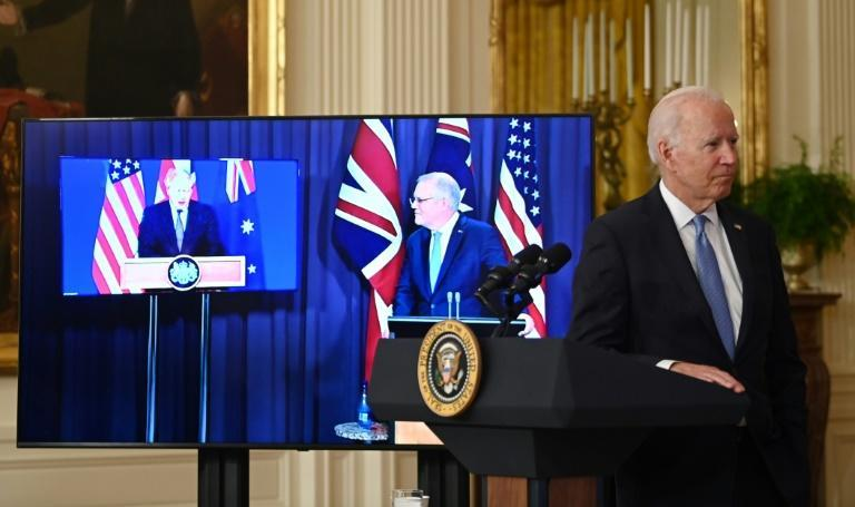 Speaking at a virtual press conference with British Prime Minister Boris Johnson (left) and US President Jow Biden, (right) Australian Prime Minister Scott Morrison (centre) announced his country was going nuclear (AFP/Brendan SMIALOWSKI)