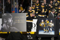Boston Bruins' Zdeno Chara is honored before their NHL hockey game against the Arizona Coyotes for playing in his 1,500th NHL game and his 1,000th game as captain of the Boston Bruins during the first period of an NHL hockey game Saturday, Feb. 8, 2020, in Boston. (AP Photo/Winslow Townson)