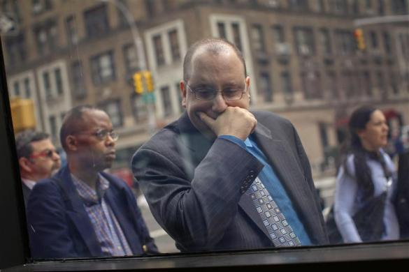 A man waits in line to enter the UJA-Federation Connect to Care job fair in New York, March 21, 2012.