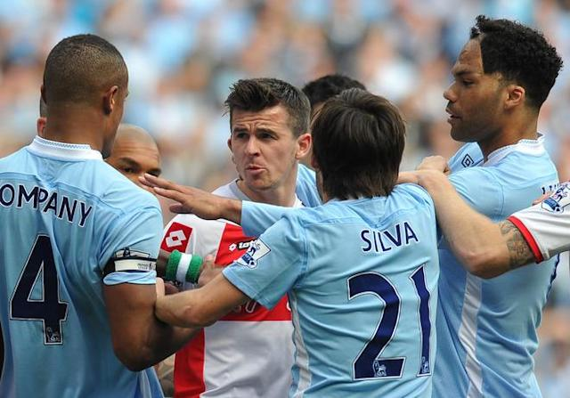 Queens Park Rangers' English midfielder Joey Barton (2nd L) clashes with Manchester City's Belgian defender Vincent Kompany (L) during the English Premier League football match between Manchester City and Queens Park Rangers at The Etihad stadium in Manchester, north-west England on May 13, 2012. AFP PHOTO/PAUL ELLIS RESTRICTED TO EDITORIAL USE. No use with unauthorized audio, video, data, fixture lists, club/league logos or 'live' services. Online in-match use limited to 45 images, no video emulation. No use in betting, games or single club/league/player publications.PAUL ELLIS/AFP/GettyImages