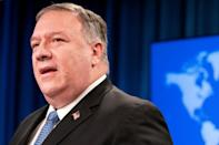 Secretary of State Mike Pompeo, seen addressing reporters on November 10, 2020, is insisting before an international trip that President Donald Trump will remain in power