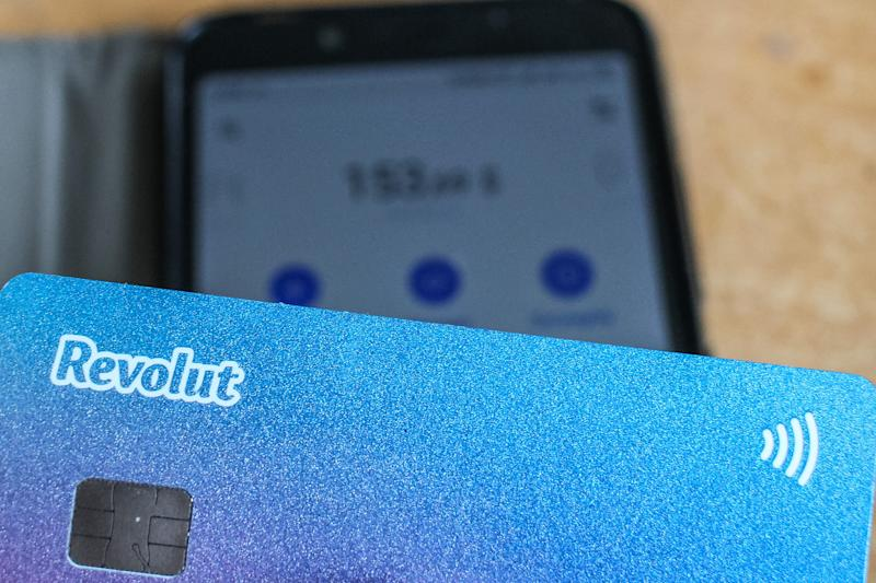 Revolut card in front of Android Revolut mobile app launched on the smartphone is seen in Gdansk, Poland on 9 July 2019 Revolut reached over 400.000 users in Poland this year. The number of Polish clients increased by 100% in 9 months period. Revolut Ltd is a UK financial technology company that offers banking services (Photo by Michal Fludra/NurPhoto via Getty Images)