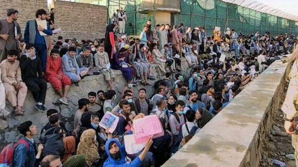 PHOTO: Crowds of people wait outside the airport in Kabul, Afghanistan, Aug. 25, 2021. in this picture obtained from social media. (David Martinon via Reuters)