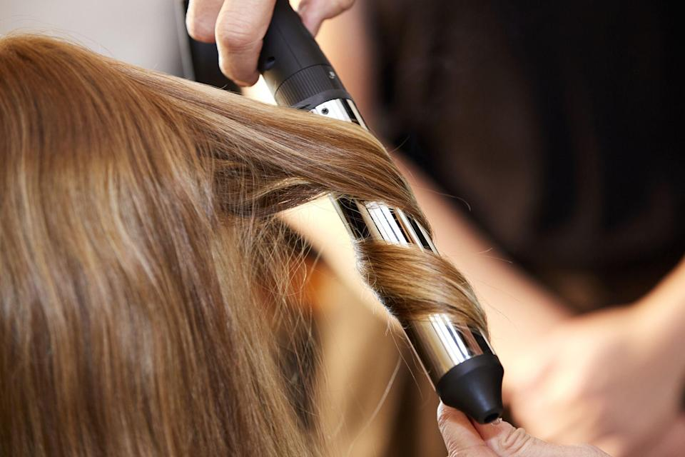 """<p>Here's a cold, hard fact about hair styling: Basically everything we do to style our hair causes damage, especially working with heat. That's why so many stylists encourage their clients to find the best heat protectant for hair—it's helpful to have a product that keeps your tresses healthy and shiny between cuts and professional treatments. </p><p>Ree Drummond knows firsthand how harsh high heat can be on hair. She blow dries her hair almost every morning at home (these days she's using the <a href=""""https://www.amazon.com/Dyson-Supersonic-Hair-Dryer-Fuchsia/dp/B01FIG1JIM?tag=syn-yahoo-20&ascsubtag=%5Bartid%7C2164.g.34919086%5Bsrc%7Cyahoo-us"""" rel=""""nofollow noopener"""" target=""""_blank"""" data-ylk=""""slk:Dyson Blow Dryer"""" class=""""link rapid-noclick-resp"""">Dyson Blow Dryer</a>), and she <a href=""""https://www.thepioneerwoman.com/beauty/hair/a33277557/how-to-blow-dry-hair/"""" rel=""""nofollow noopener"""" target=""""_blank"""" data-ylk=""""slk:does her own hair"""" class=""""link rapid-noclick-resp"""">does her own hair</a> when she shoots episodes of her show, <em>The Pioneer Woman.</em> Between the styling and the coloring she does to keep <a href=""""https://www.thepioneerwoman.com/beauty/hair/a33863713/ree-drummond-red-hair-shampoo/"""" rel=""""nofollow noopener"""" target=""""_blank"""" data-ylk=""""slk:her signature red locks"""" class=""""link rapid-noclick-resp"""">her signature red locks</a> looking shiny and bright, some split ends and a little damage are inevitable. </p><p>The good news is that you can work to prevent heat damage with one simple step: Just add a heat protectant to your hair-styling routine for an extra layer of defense against breakage. These products work by creating a physical barrier between your locks and hair tools, some of which can get as hot as 450 degrees Fahrenheit! While heat is the culprit most of the time, it's also important to note that damage can start even earlier, in the shower: Hard water can be rough on your tresses too (luckily there are <a href=""""https://www.thepioneerwoman.com/beauty"""
