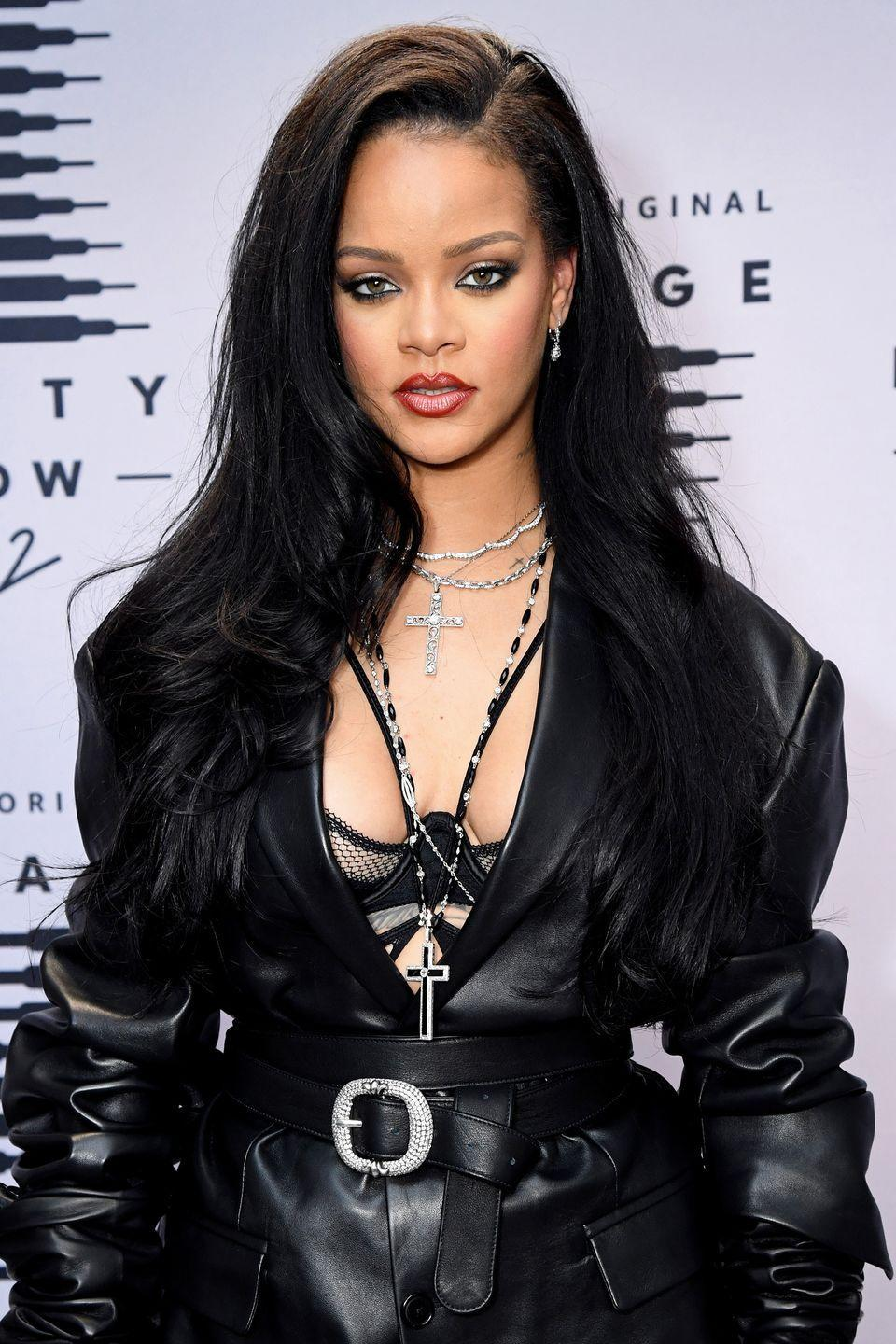 <p>Rihanna wears her jet black hair in a voluminous blowout parted to one side. </p>