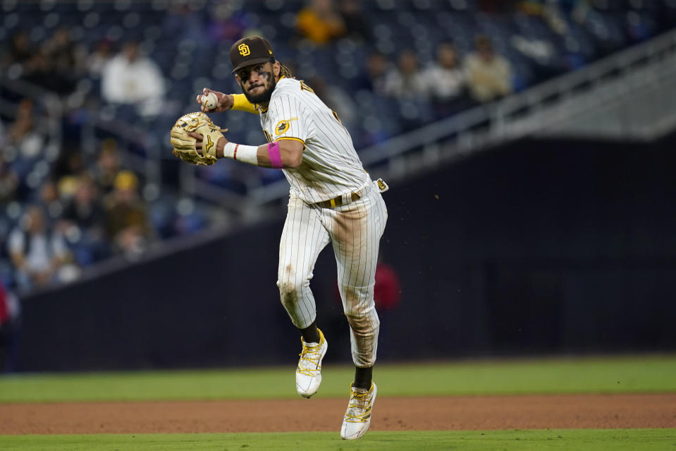 San Diego Padres shortstop Fernando Tatis Jr. throws to first for the out on New York Mets' Brandon Drury during the eighth inning of a baseball game Thursday, June 3, 2021, in San Diego. (AP Photo/Gregory Bull)
