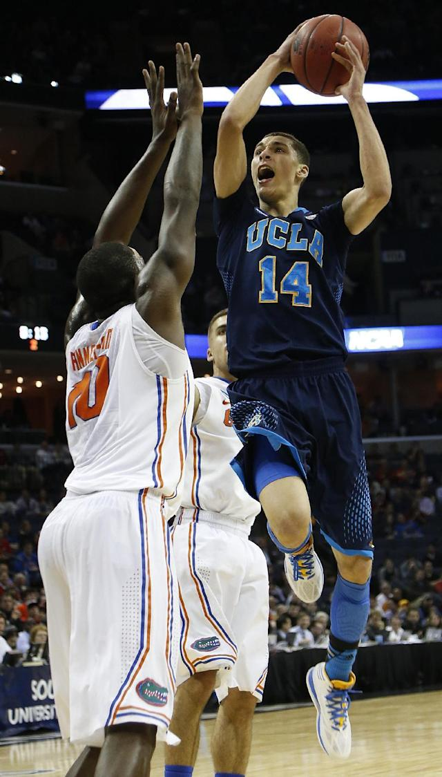 UCLA guard Zach LaVine (14) shoots against Florida forward Dorian Finney-Smith (10) during the second half in a regional semifinal game at the NCAA college basketball tournament, Thursday, March 27, 2014, in Memphis, Tenn. (AP Photo/Mark Humphrey)