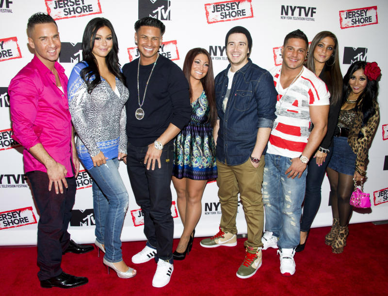 "FILE - This Oct. 24, 2012 photo shows ""Jersey Shore"" cast members, from left, Mike ""The Situation"" Sorrentino, Jenni ""JWoww"" Farley, Paul ""Pauly D"" Delvecchio,  Deena Cortese, Vinny Guadagnino, Ronnie Ortiz-Magro, Sammi ""Sweetheart"" Giancola and Nicole ""Snooki"" Polizzi at a panel entitled ""Love, Loss, (Gym, Tan) and Laundry: A Farewell to the Jersey Shore"" in New York. MTV, home of the ""Jersey Shore"" reality show, plans to air a fundraising special to help rebuild New Jersey's devastated shoreline. The one-hour program will air Nov. 15 from MTV's Times Square studio in New York City. It will feature the cast of ""Jersey Shore"" along with other guests. The network said Monday the program will solicit contributions for the rebuilding of Seaside Heights, the heart of the Jersey shore and the principal setting for the ""Jersey Shore"" series.  (Photo by Charles Sykes/Invision/AP, file)"