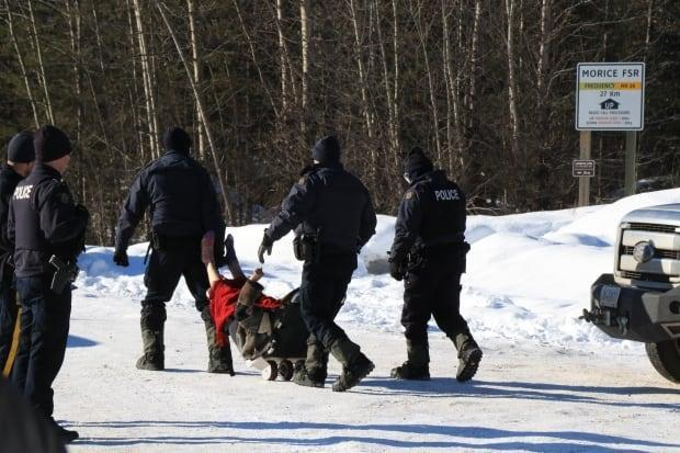 Police take a protester into custody last year during potests related to the Coastal GasLink pipeline being built from Dawson Creek to Kitimat, B.C.