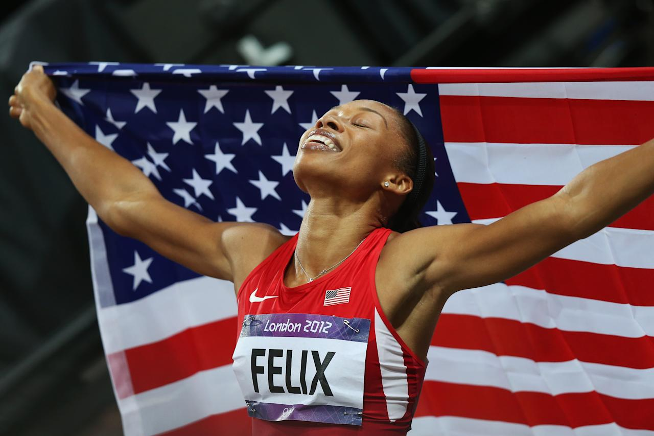 LONDON, ENGLAND - AUGUST 08:  Allyson Felix of the United States celebrates after winning gold in the Women's 200m Final on Day 12 of the London 2012 Olympic Games at Olympic Stadium on August 8, 2012 in London, England.  (Photo by Ezra Shaw/Getty Images)